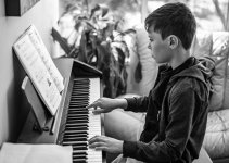 Kid practicing with Rocket Piano